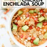 bowl of chicken enchilada soup topped with avocado, tomatoes, cheese, corn, and chips