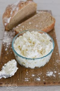 Pressure Cooker Ricotta Cheese in a glass bowl next to crusty bread