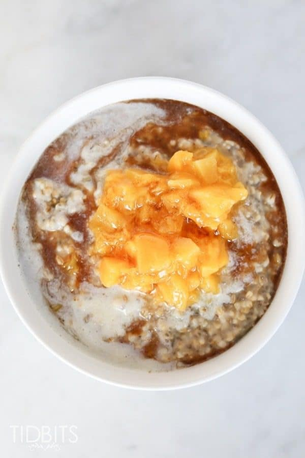 Top down shot of peaches and cream steel cut oats