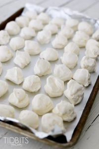 Frozen Whipped Cream Dollops laid on parchment