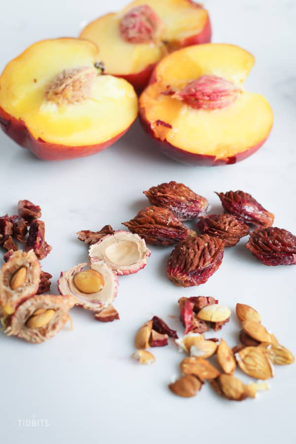 Close up of Peaches and peach stones on a white background