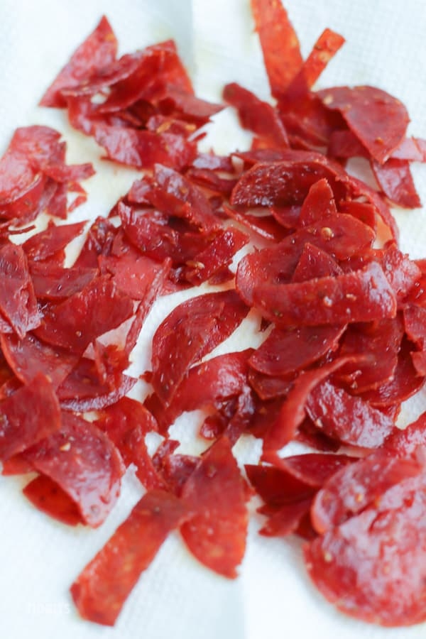 Diced pepperoni on a white background