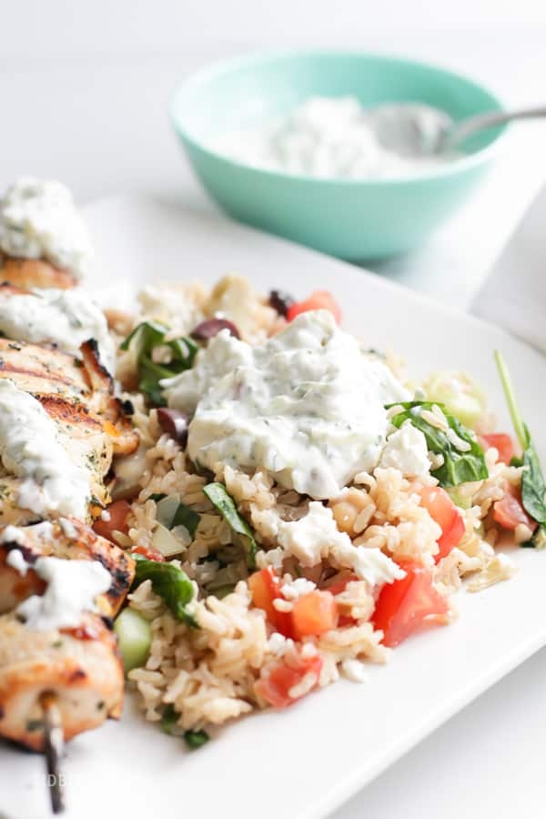 Pressure Cooker Mediterranean Brown Rice Bowls and Lemon Garlic Chicken with a dollop of tzatziki sauce