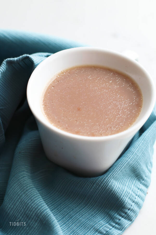 Basic Crio Bru in a white cup on a blue cloth