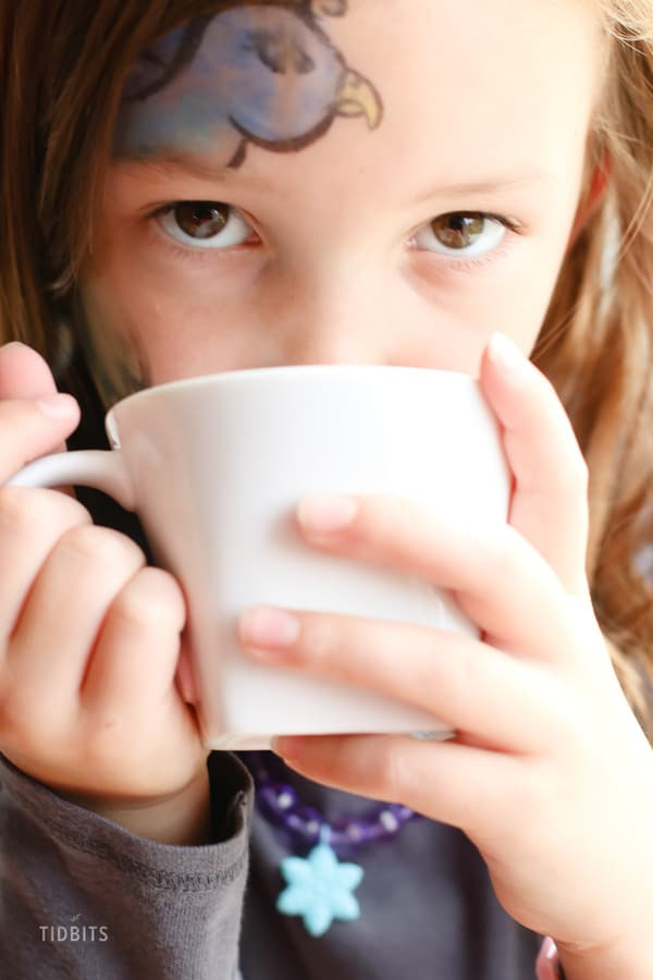 A girl drinking out of a mug