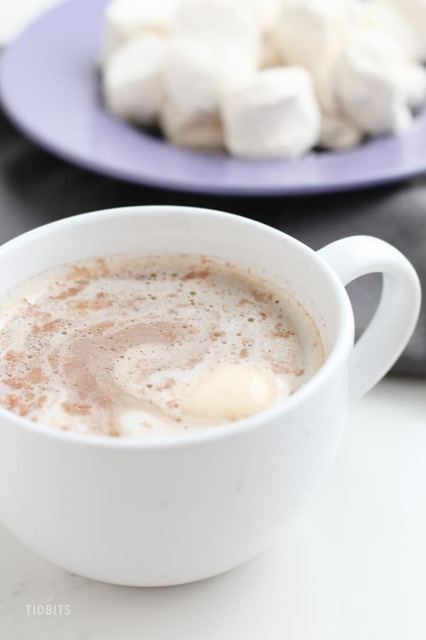 Basic Crio Bru in a white cup with a cream dollop in it