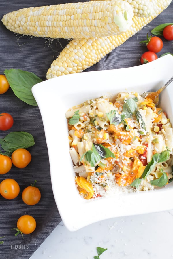 Sweet Corn and Tomato Pasta in a square white bowl