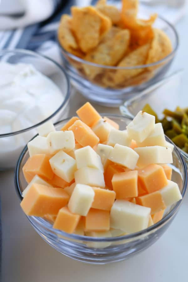 Cubes of cheddar and pepperjack cheese in a bowl