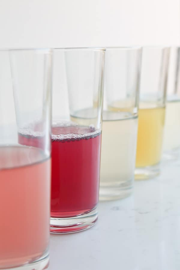 Tall glasses of infused water on a white background
