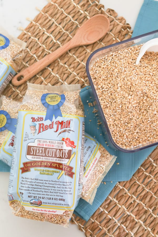 Top down shot of a package of Bob's Red Mill Oats and some poured into a glass dish