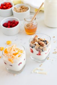 Two glasses of Instant Pot Yogurt Parfait with different toppings