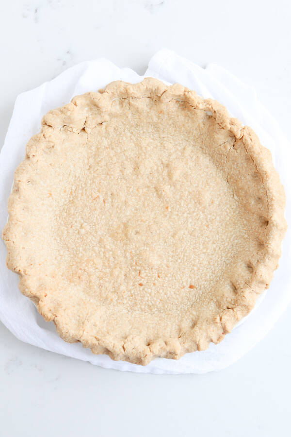 whole wheat pie crust on a white towel