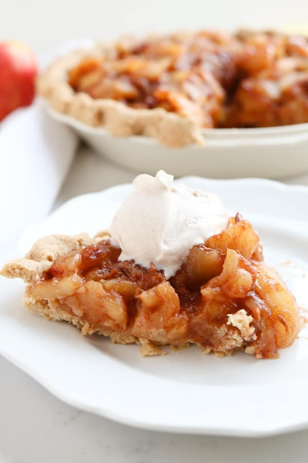 Caramel Apple Pie on a white plate with whipped cream