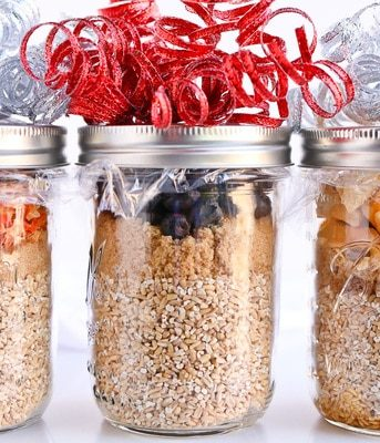 Three jars of Pressure Cooker Steel Cut Oats decorated with ribbon