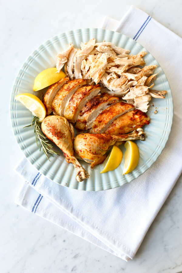 Roasted chicken on a blue serving plate