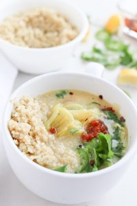 Close up of a bowl of coconut cabbage soup