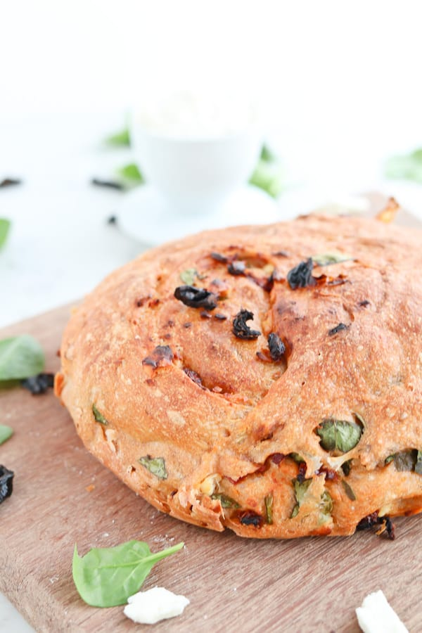 Close up of sundried tomato bread on a chopping board