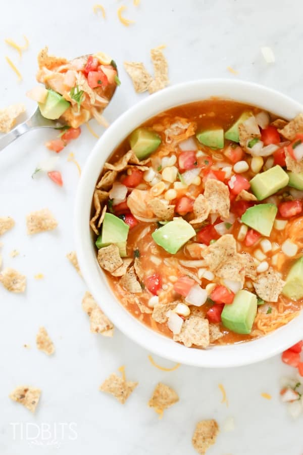 Top shot of creamy enchilada soup in a white bowl