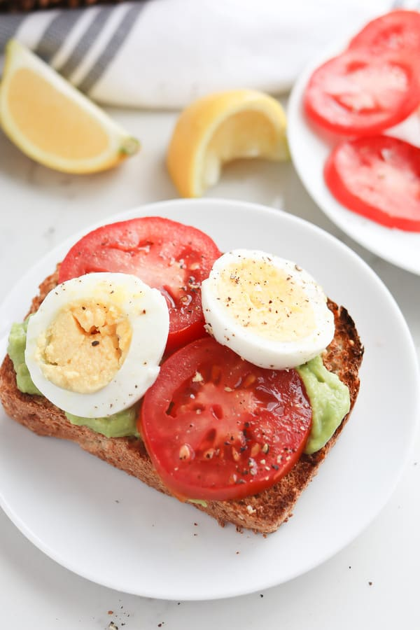 Close up of boiled eggs on an open sandwich
