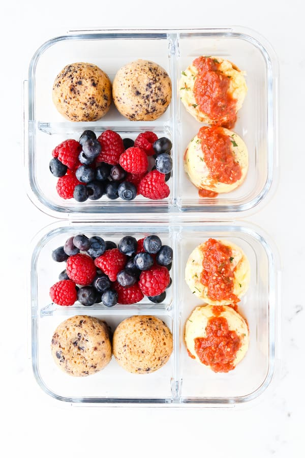 Top down shot of sous vide eggs and blueberry oatmeal muffins in a lunch box