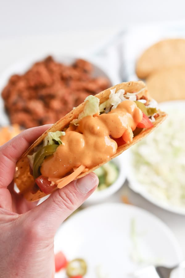 Taco with cheese sauce andPressure Cooker Instant Pot Healthy Meat and Bean Taco Filling