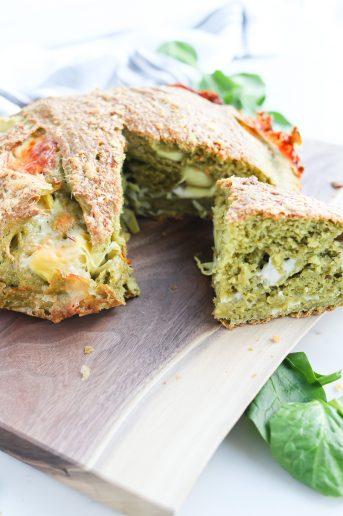 Instant Pot Cheesy Spinach Artichoke Crusty Bread on cutting board