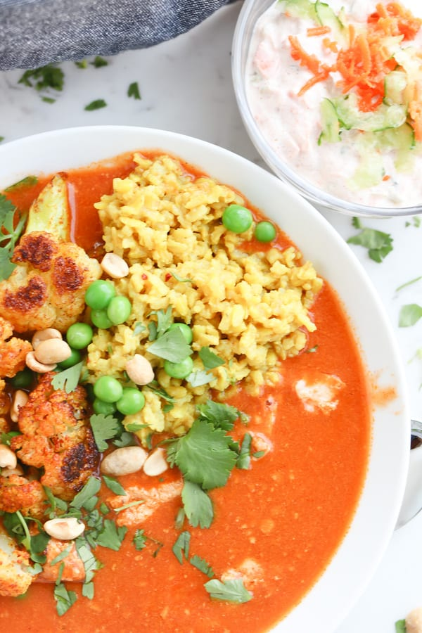 instant pot tikka masala in a bowl with toppings