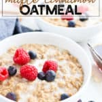 Bowl of oatmeal with cream and berries in a white bowl