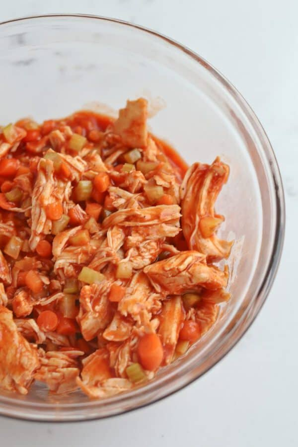 bowl of Instant Pot buffalo chicken, carrots, and celery