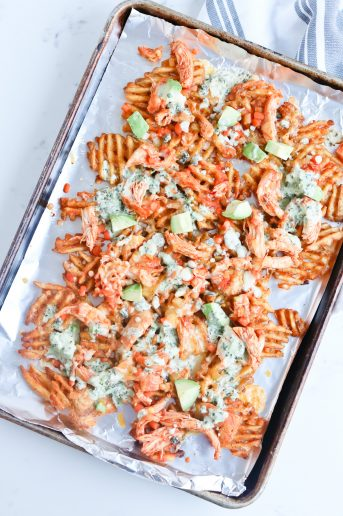 sheet pan of waffle fries and Instant Pot buffalo chicken