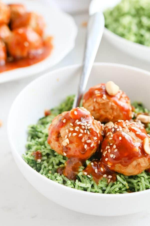 Instant Pot Kung Pao Meathballs in a bowl with green rice