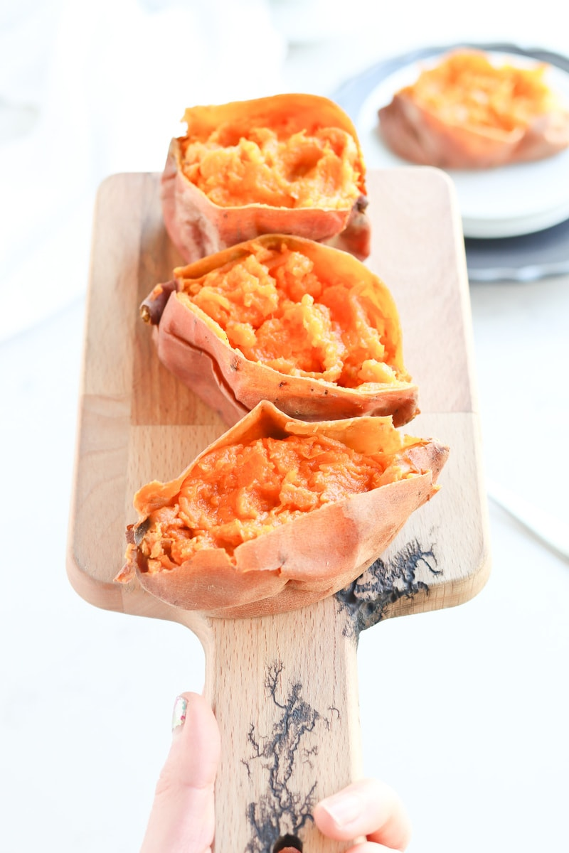 Instant Pot Sweet Potatoes on a cutting board