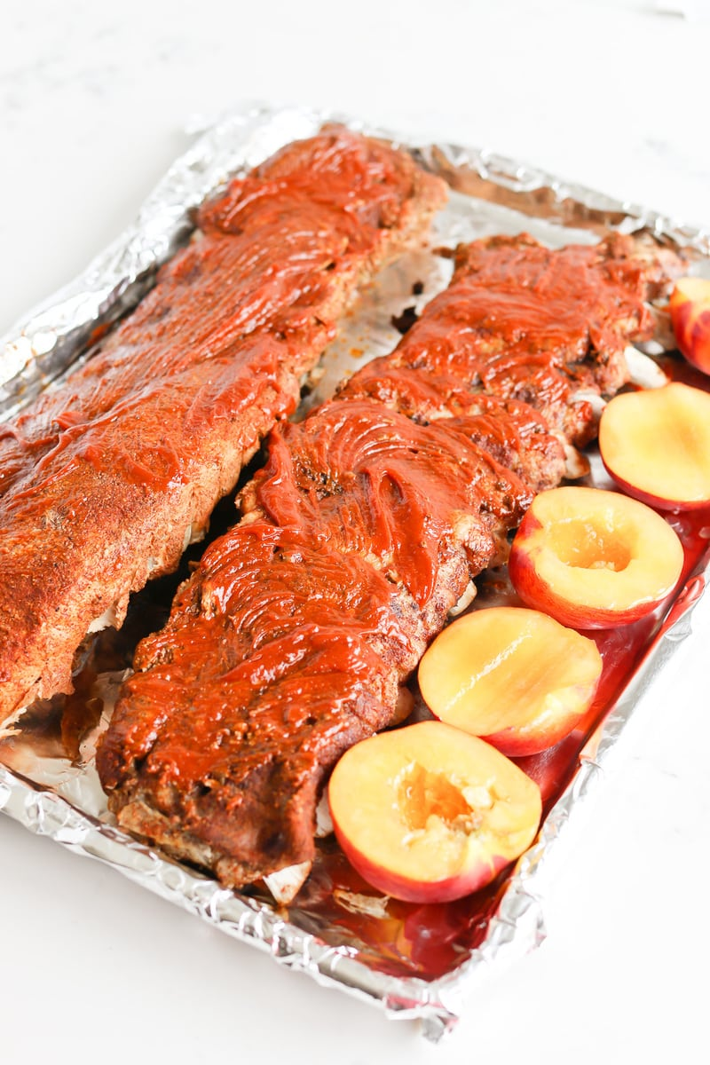 Instant Pot Chipotle Peach BBQ Ribs on a pan