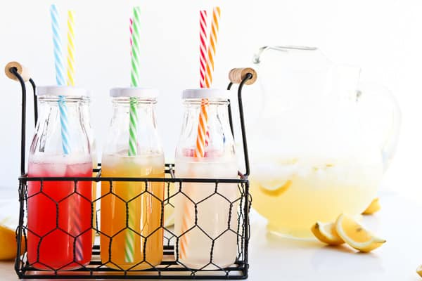 Instant Pot Lemonade in bottles with a straw