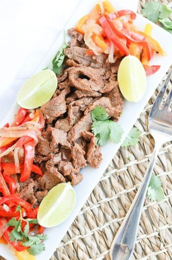 Instant Pot Steak Fajitas on a plate with peppers and onions