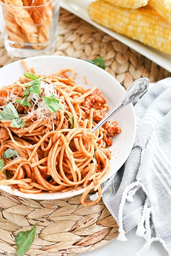 Bowl of spaghetti with fresh basil