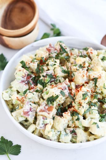 bowl of potato salad with chopped parsley