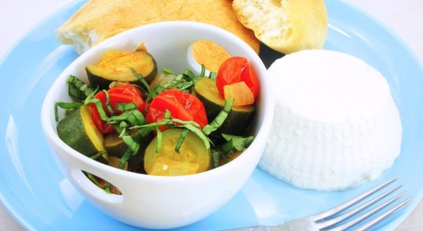 mix of tomatoes and zucchini in a white bowl