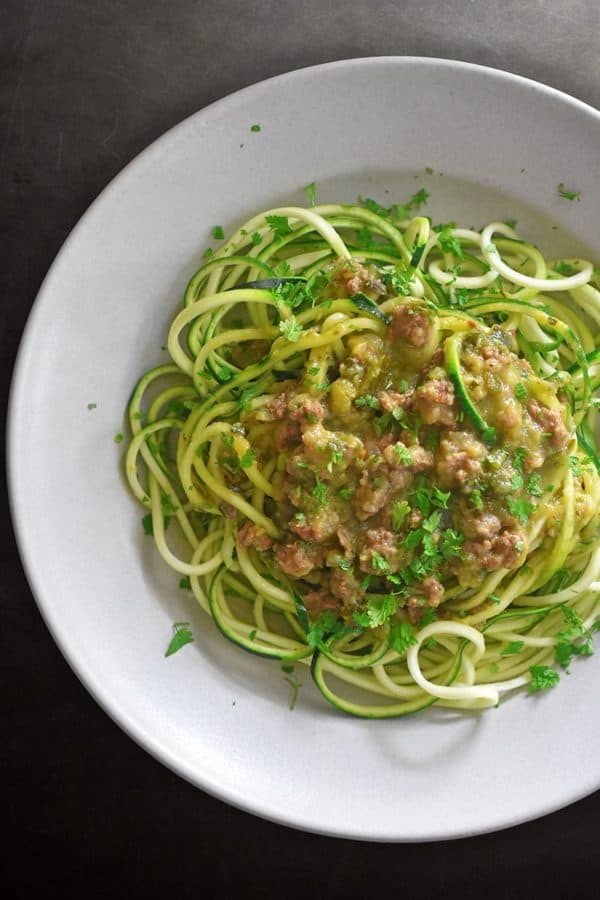 Zucchini noodles in a white bowl