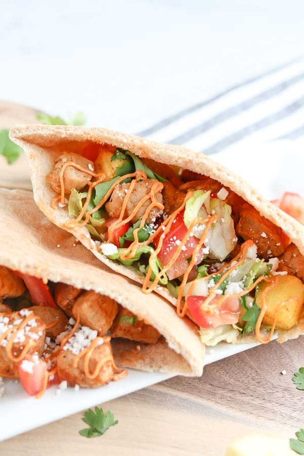 Pita filled with pork tenderloin and pineapple