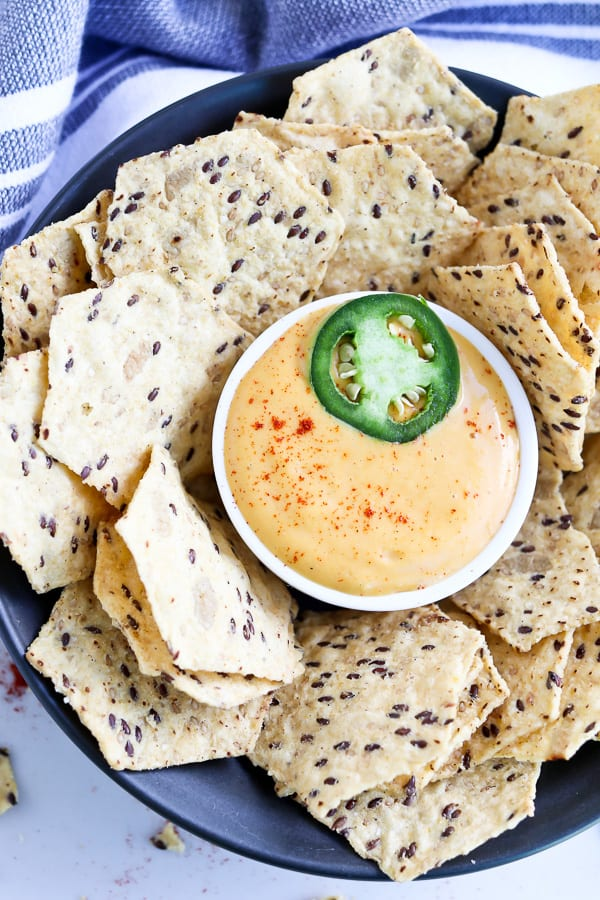 Bowl of cheese sauce with chips