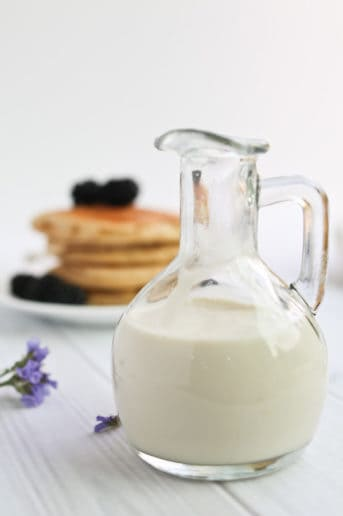 bottle of cashew cream sauce with pancakes