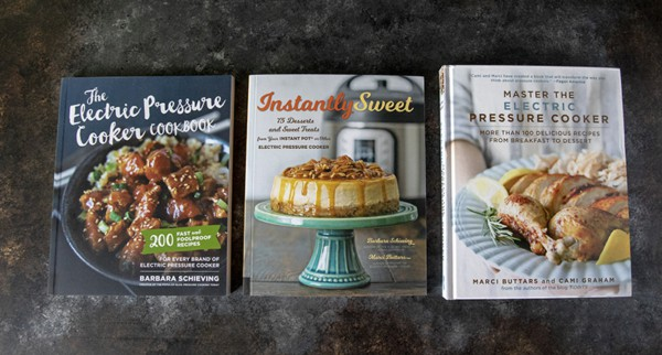Three Instant Pot Cookbooks on a black table
