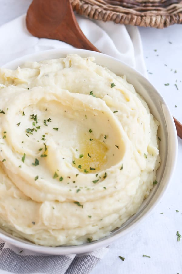 Bowl of creamy mashed potatoes with butter