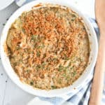 Scalloped Potatoes in a white casserole dish