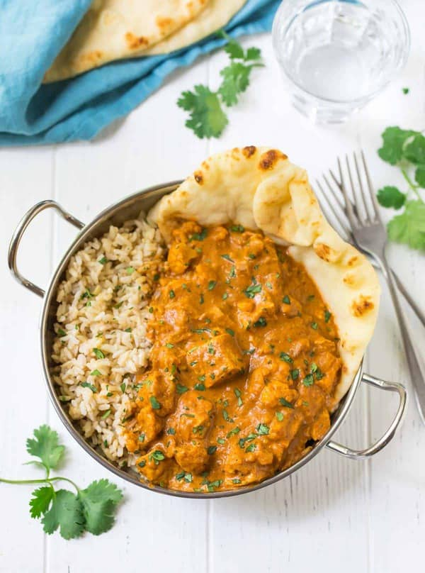 chicken and recie in a bowl with naan