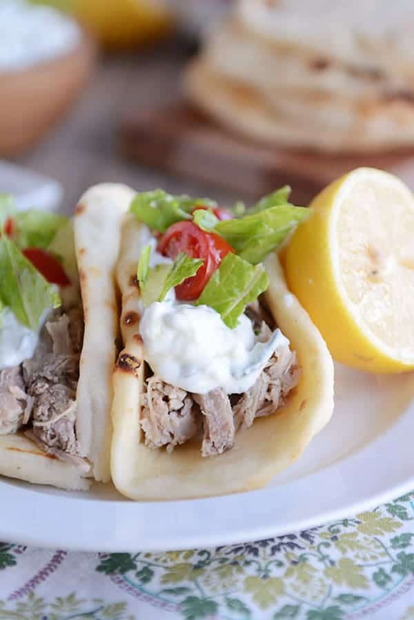 shredded pork wrapped in a pita with toppings