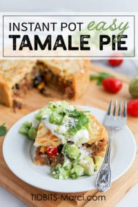 Slice of tamale pie with sour cream and green salsa over top