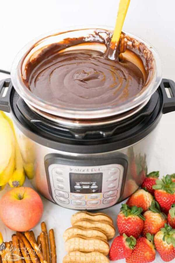 Fondue in an instant pot with various fruit and crackers