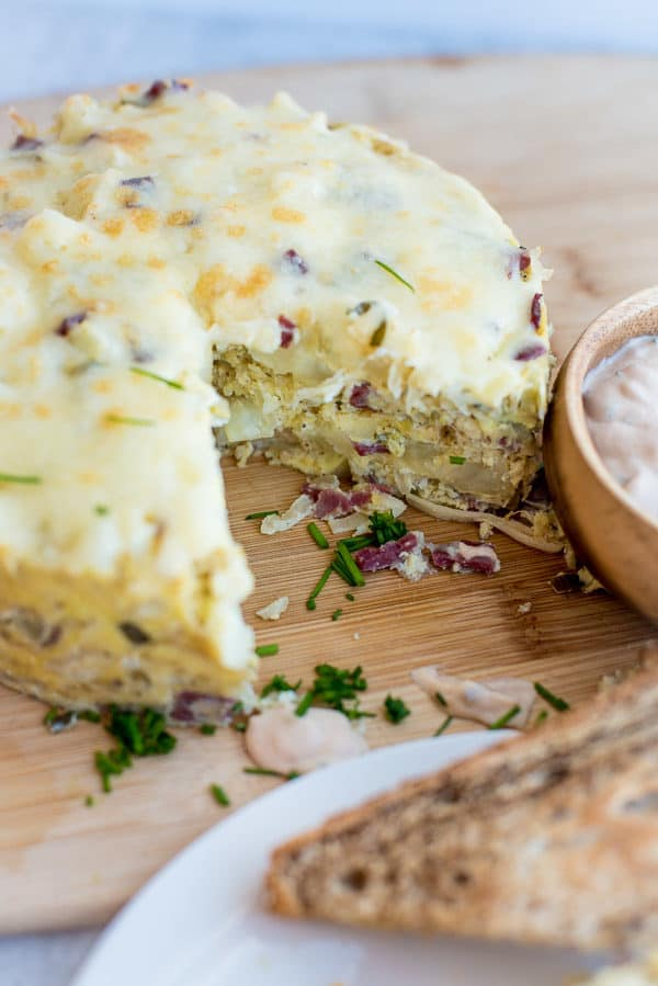 Frittata on a wood cutting board with toast